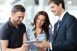 Employee helping happy customers