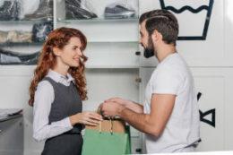 Employee helping customer